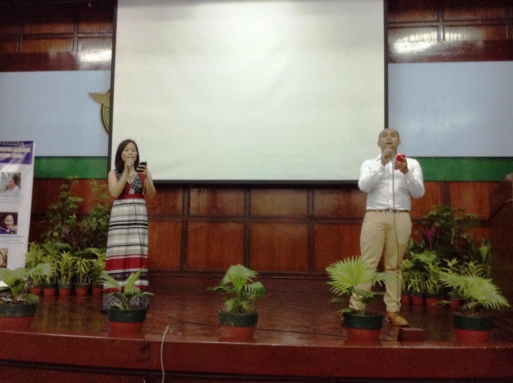 Teacher JM Dela Pena and Ms. Michelle Agas serenade the audience