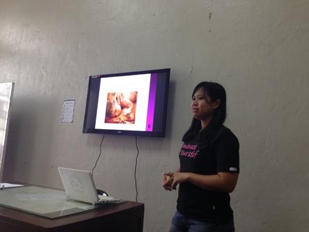 Speaker explains breast self-exam