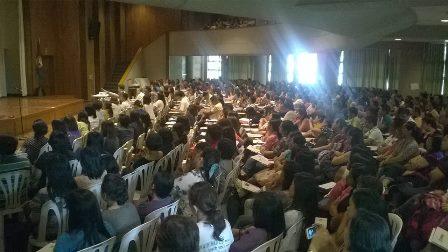 Symposium participants fill NISMED auditorium