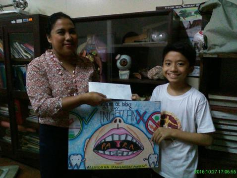 """Health Promotion through Poster Making focusing on the theme """"Ngipin at Bibig Ingatan Para sa Malusog na Pangangatawan"""""""